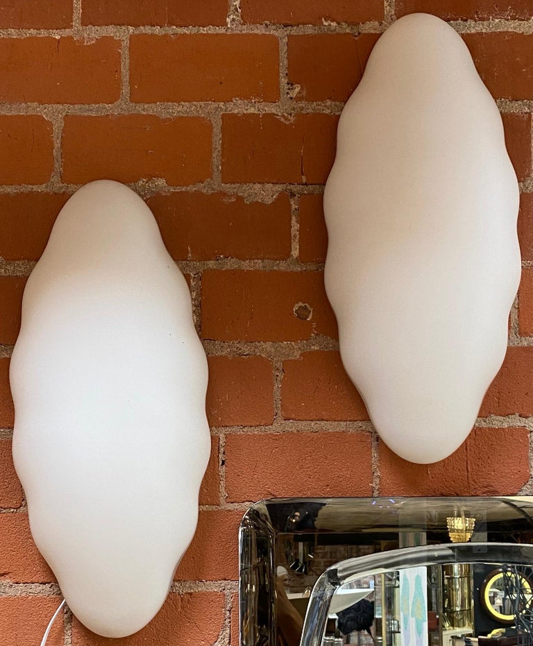 Beautiful pair of two Esperia wall sconces in opaline glass, the sconces are in perfect condition and they have a very particular design that would enrich any Mid-Century Modern environment.