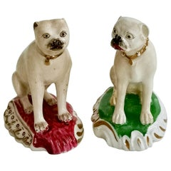 Pair of Two Rockingham Porcelain Pug Dogs on Rococo Base, circa 1835