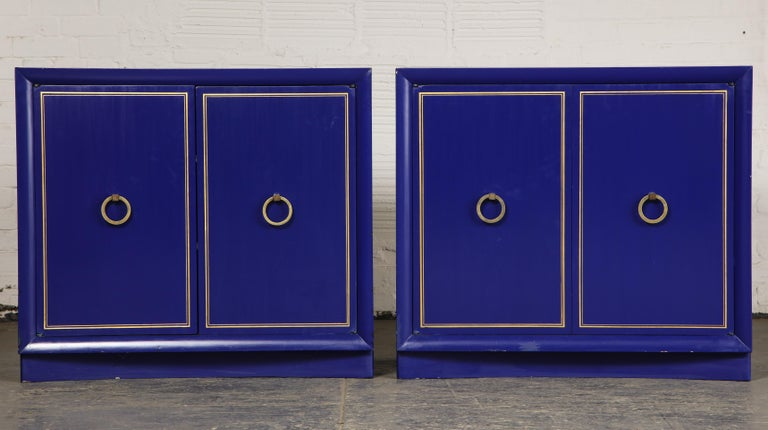 Each fitted with two-cabinet doors with gilt banding opening to two shelves.