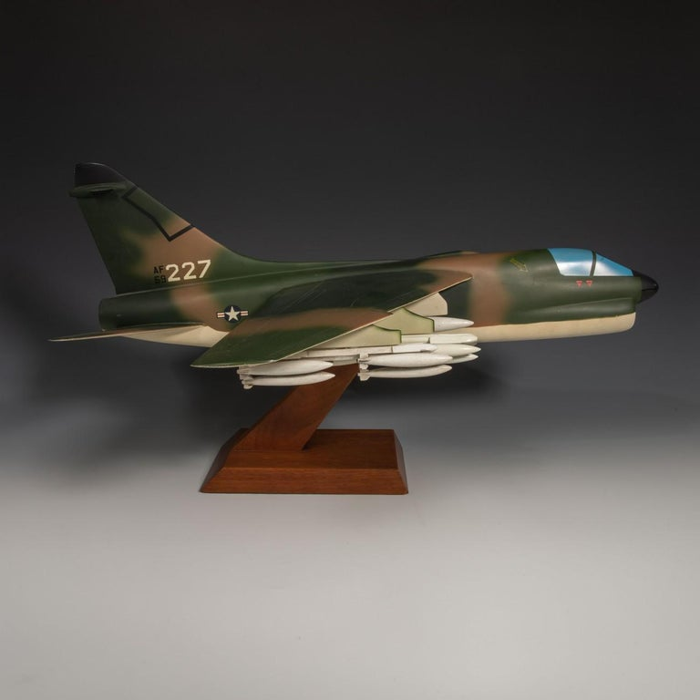 An unusual pair of painted aluminium and wood military models of the LTV ( Ling-Temco-Vought) A-7 Corsair II. One in United States Navy (USN) livery and one in United States Air Force camouflage livery. Made by a celebrated Dutch model maker,