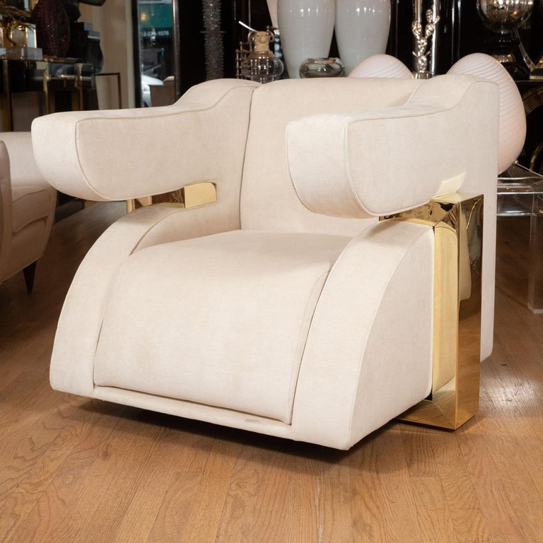 Pair of unusual stylized brass and upholstered armchairs.