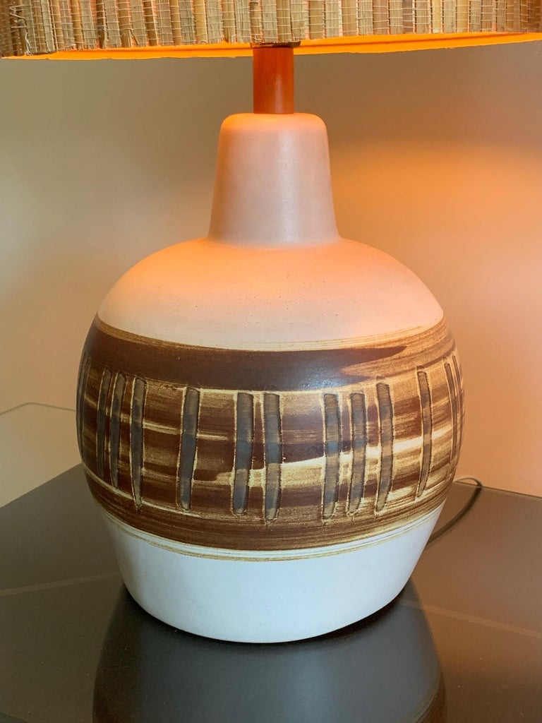 A pair of unusual ceramic lamps by Gordon Martz for Marshall studios decorated with vertical lines.