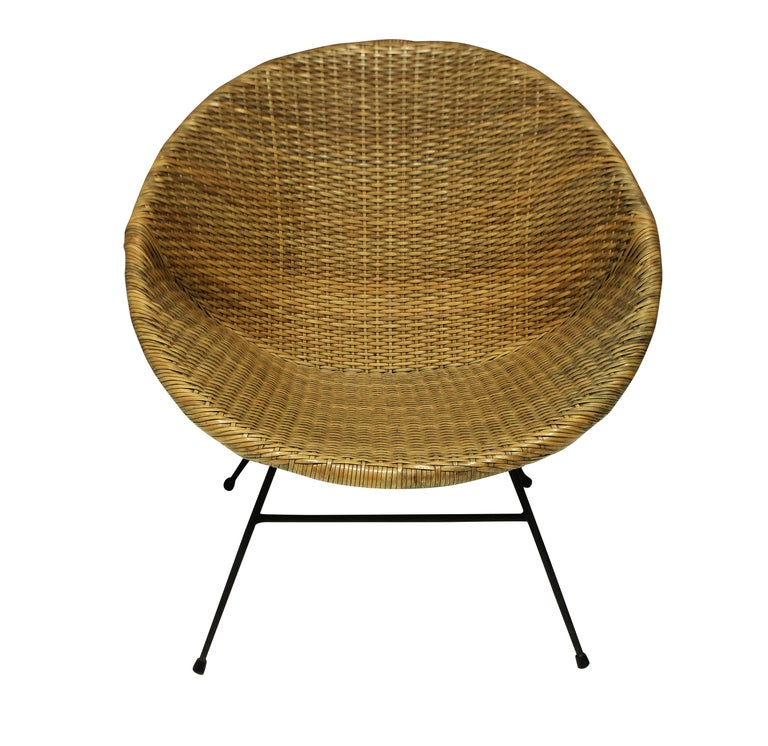 A pair of French midcentury rattan chairs of unusual design, with metal frames and cone shaped seats.