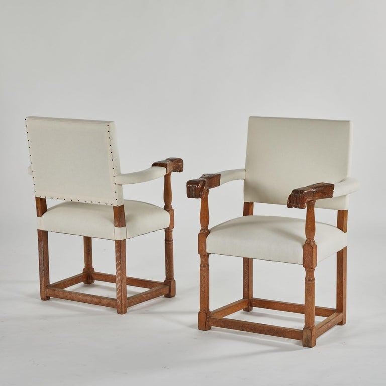 English Pair of Upholstered Armchairs with Carved Arms as Hands For Sale