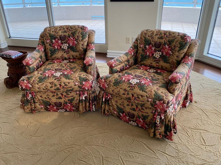 This pair of armchairs are comfortable upholstered in Schumacher Chintz with a quitting design around flowers and leaves.