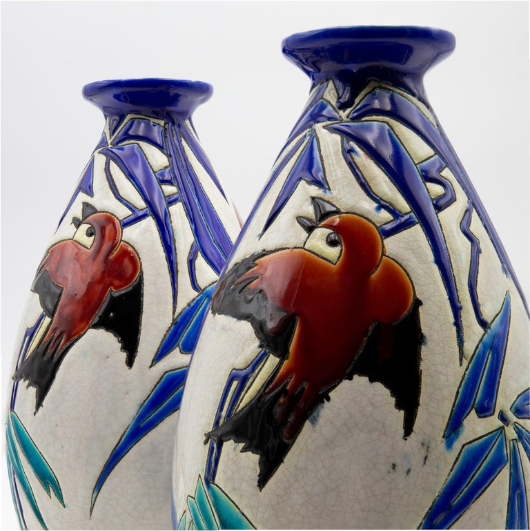 A vintage Art Deco period pair of vases from circa 1930. Designed by Charles Catteau and manufactured by Boch Keramis in Belgium. Stamped Keramis Made in Belgium.