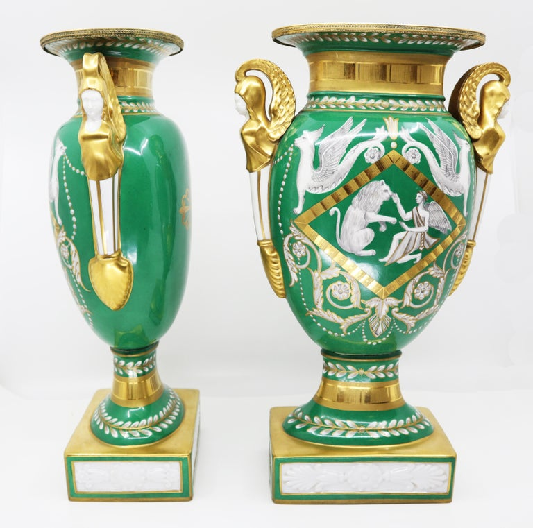 Pair of vases, Empire style 19th century Paris Decorated with neoclassical design pattern in white and gold against a green background Dimensions 40 H x 20 W x 12cm (Approx).   Ref AACPO57  *Shipping included  Free and fast delivery door to door by