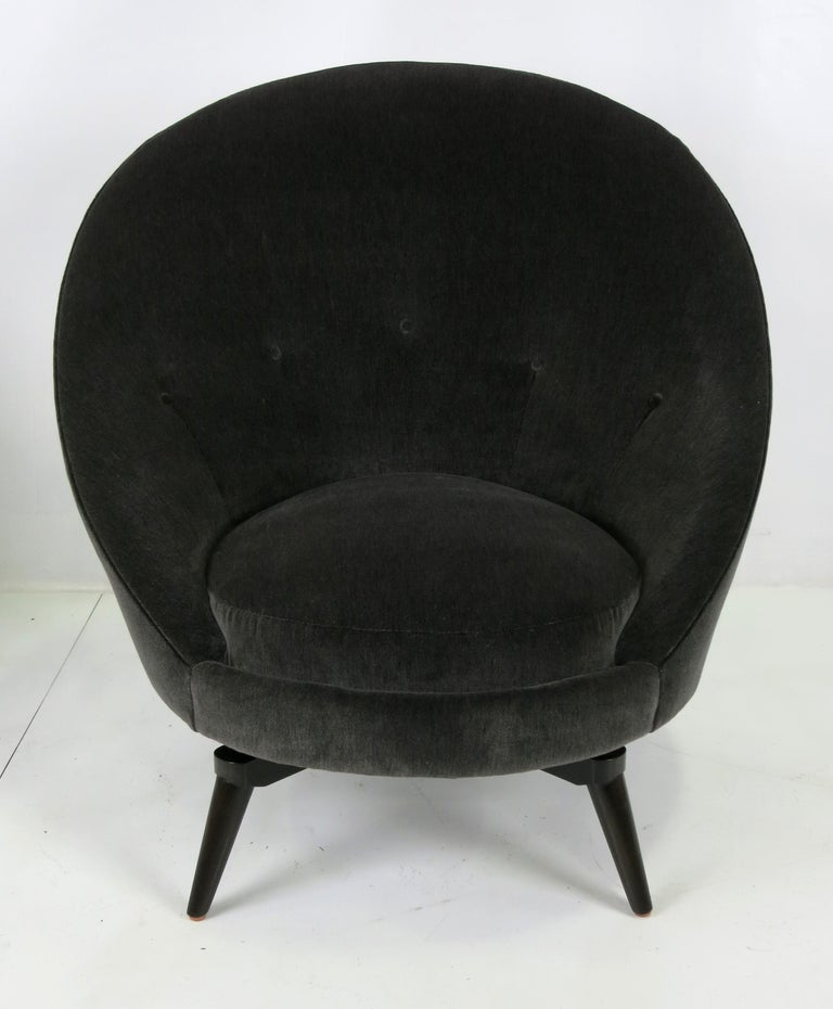 Pair of swivel egg chairs. Meticulously constructed on spider leg swivel bases. The pair are freshly upholstered in luxurious heavy weight charcoal grey velvet. The swivel bases have been reconstructed from the originals and are stouter and more