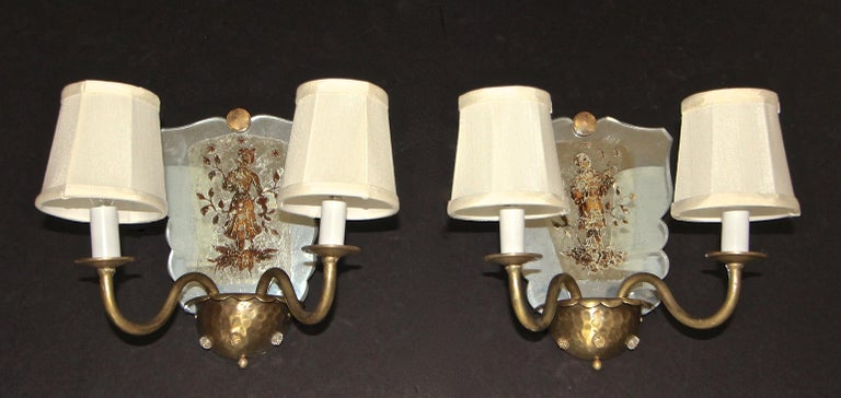 Pair of Venetian mirrored gold metal 2-arm wall sconces with applied classical figures decoration to mirrored backs. Each uses two candelabra size bulbs, newly wired. Shades included.