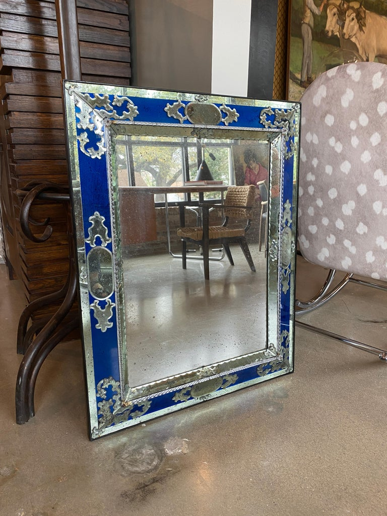 Matched pair of rectangular Venitian mirrors with cobalt blue glass and charming patina to mirror glass. Zoom in on photos. Early to mid-20th century, Italy.