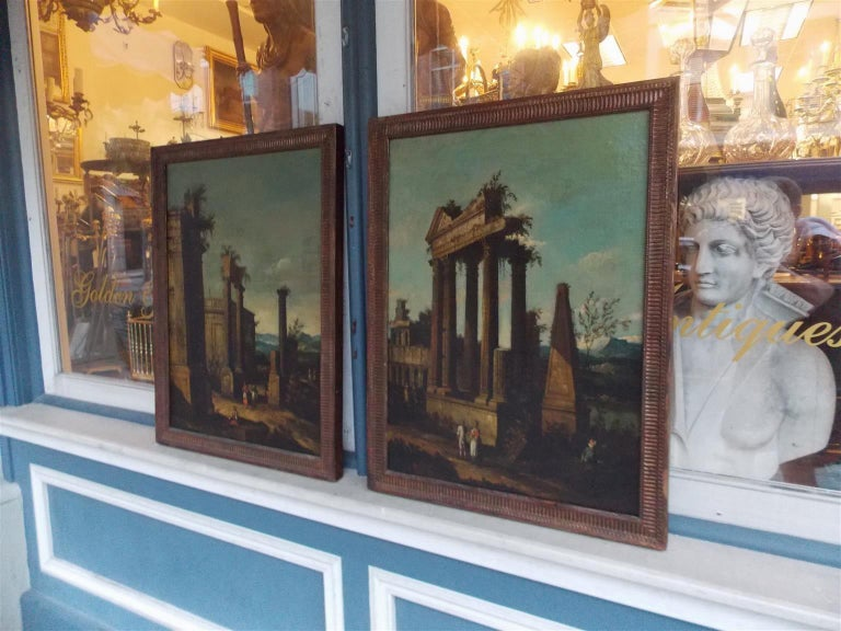 Pair of Venetian oil on canvas paintings of architectural ruins in the original gilt fluted beaded frames with original rear stretchers. Early 19th century.