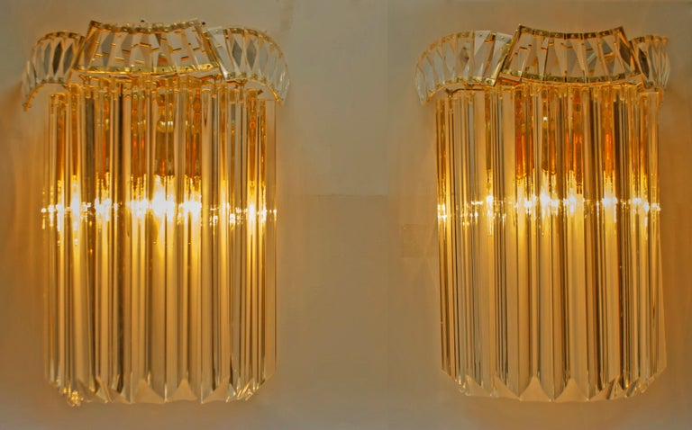 This pair of sconces consists of 9 Triedri each, in Murano glass and was produced by Venini in the 1970s, in Liberty style, they have a gilded brass structure.  Paolo Venini (1895-1959) emerged as one of the leading figures in the production of
