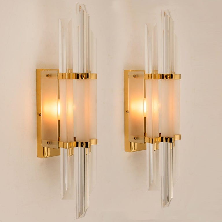 1 of the 2 beautiful pair of Murano glass wall sconces featuring three long crystal clear glass