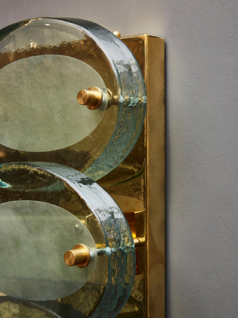 Late 20th Century Pair of Vertical Wall Sconces in Brass with Murano Glass Lenses For Sale