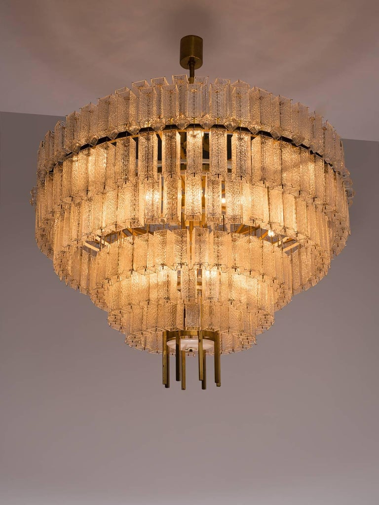 European Pair of Very Large Circular Chandeliers in Brass and Structured Glass For Sale