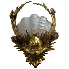 Pair of Very Rare J. E. Caldwell Bronze and Glass Shell form Sconces