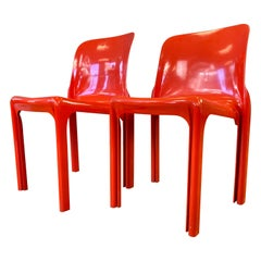 Pair of Vico Magistretti designed Selene Stacking Chairs for Artemide in Red