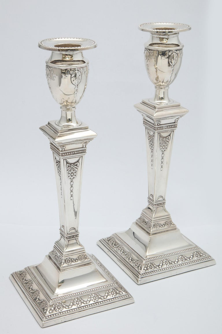 Pair of Victorian, Adam-Style, sterling silver candlesticks, Sheffield, England, 1898, William Charles Fordham and Albert Faulkner (Fordham and Faulkner) - makers. Each candlestick measures 10 inches high x 4 inches wide (across square base) x 4