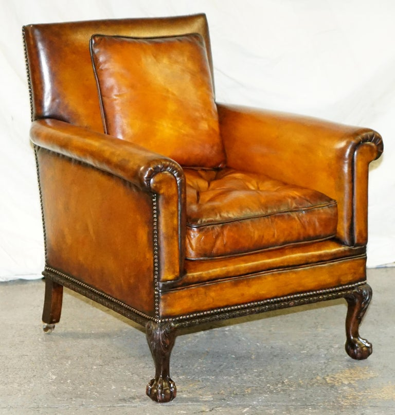 We are delighted to offer for sale this stunning and original pair of circa 1860 club armchairs with hand carved claw & ball feet and brown leather upholstery  A very original and good looking pair, it is rare to find club armchairs from this