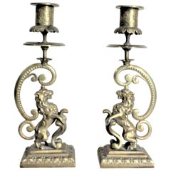Pair of Victorian English Cast Brass Candlesticks with Rearing Figural Lions