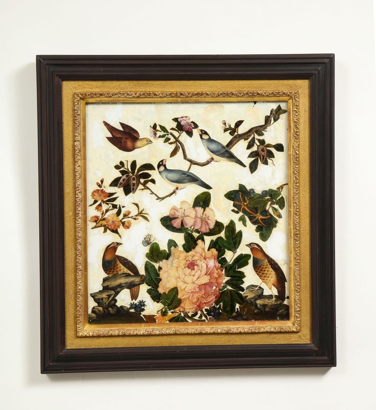 Each depicting various birds and butterflies set amongst peonies, dahlias, phlox and other country flowers on a white ground. In an ebonized wood frame with gilt gesso inner slip.