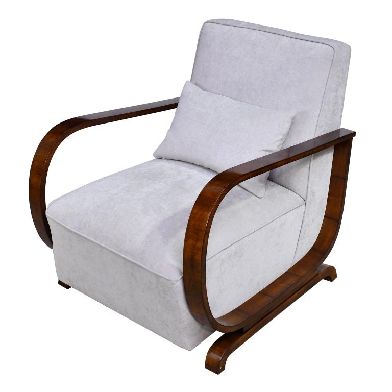 A pair of Art Deco armchairs with walnut frames, upholstered seat and back, Vienna, Austria, circa 1930. Chairs are expertly upholstered in a pale-grey, soft velvet or velveteen fabric and come with two lumbar pillows. Very comfortable! Measures: