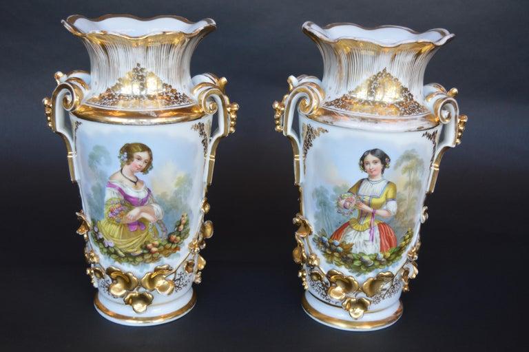 Large pair of vieux Paris gilt porcelain vases with transfer printed portraits.