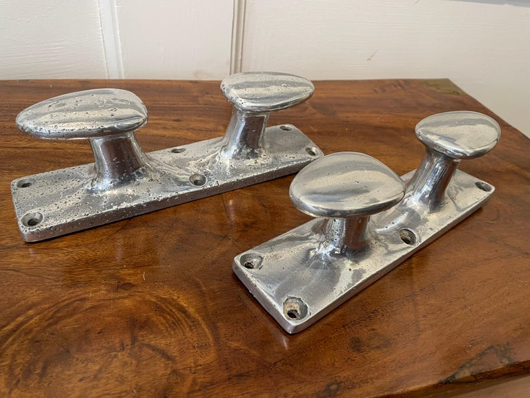 20th Century Pair of Vintage Aluminum Ship's Cleats or Mounted Coat Hooks For Sale