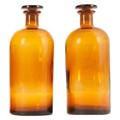 Pair of Vintage Amber Glass Apothecary Jars with Lids
