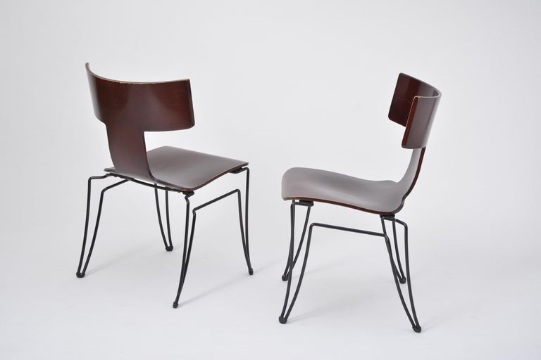This set of two chairs was produced by Donghia in the 1980s. The model Anziano was designed by John Hutton. The structures are made of black coated steelwire, the seats are made of molded beechwood veneer. The chairs are stackable.