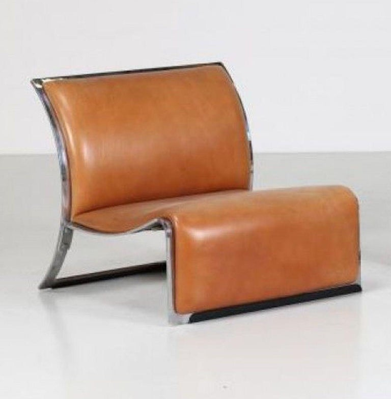 Pair of Vintage Italian armchairs in chromed metal and leather designed by Vittorio Introini in the 1960s for Saporti Italia 1965.  Very Good conditions.