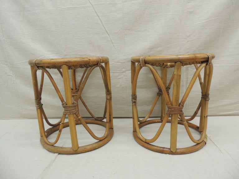 """Pair of vintage bamboo and rattan round stools or side tables. Size: 12"""" D x 13.5"""" H."""