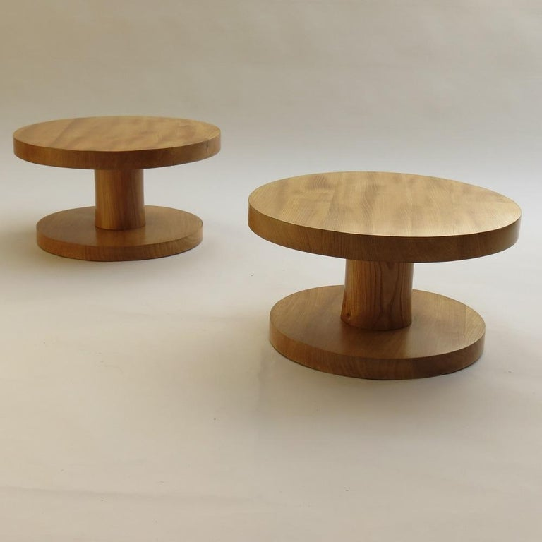 Wonderful pair of handmade bespoke side tables, made from solid elm. These have been hand produced, turning the wood on a lathe. The wood has cracked as it has dried over time adding to the wonderful character of these tables. Dates from the