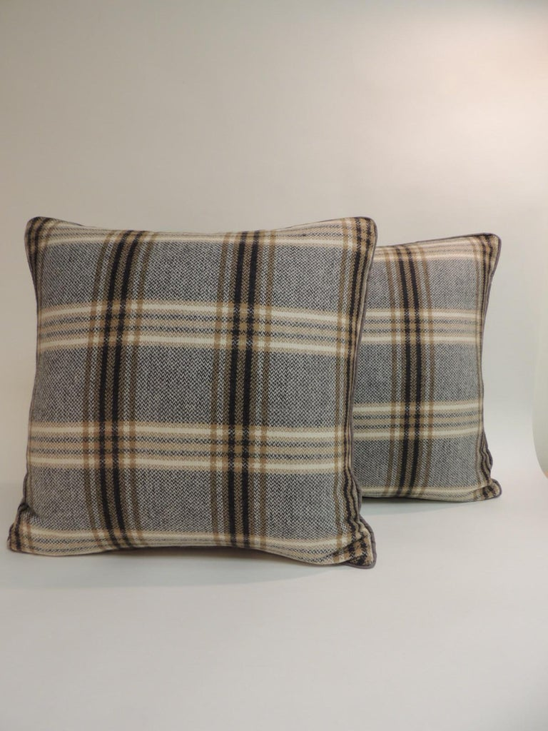 Pair of vintage black and grey tartan/plaid woven wool decorative pillows. Double sided pillow with grey color linen welt. This fabric was a favorite of Parisian Fashion designer Pierre Cardin in the 1950s. Found in Paris. Decorative pillow