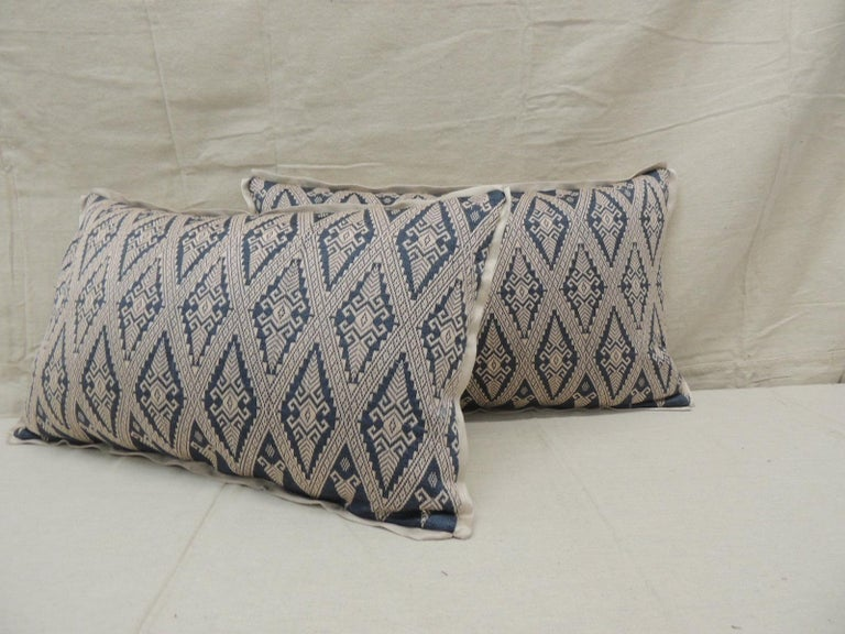 Pair of vintage blue and beige Asian silk woven Lumbar decorative pillows Trellis embroidered patterns, natural silk threads on blue silk. Finished with natural color silk backings.  Pillows handcrafted and designed in the USA.  Custom pillow