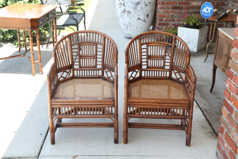 Vintage pair of bamboo Brighton chairs with cane seats.