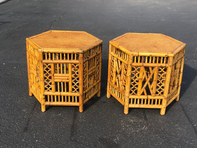 Pair of vintage Brighton style bamboo tables. These are identical in size but they vary in pattern. They are not matching tables. Please look at photos closely. Stron quality. Wicker table top over solid wood. Signed Calif-Asia underneath, from the