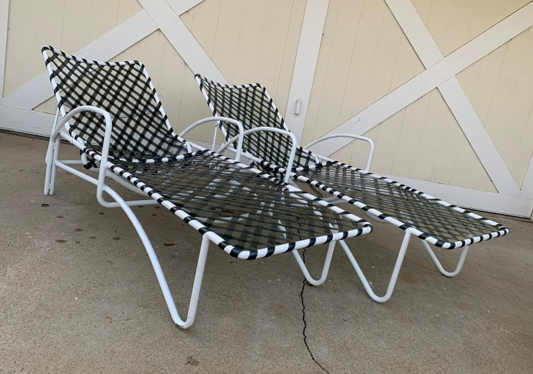 Rare Brown Jordan Lido chaise lounge chairs in white with greenish vinyl strapping. In good vintage condition. Straps are solid and complete with some sun fade/oxidation. Frame shows some scratches and finish wear consistent with age and