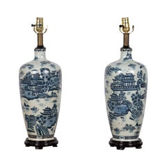 Pair of Vintage Chinese Blue and White Lamps with Architectures and Landscapes
