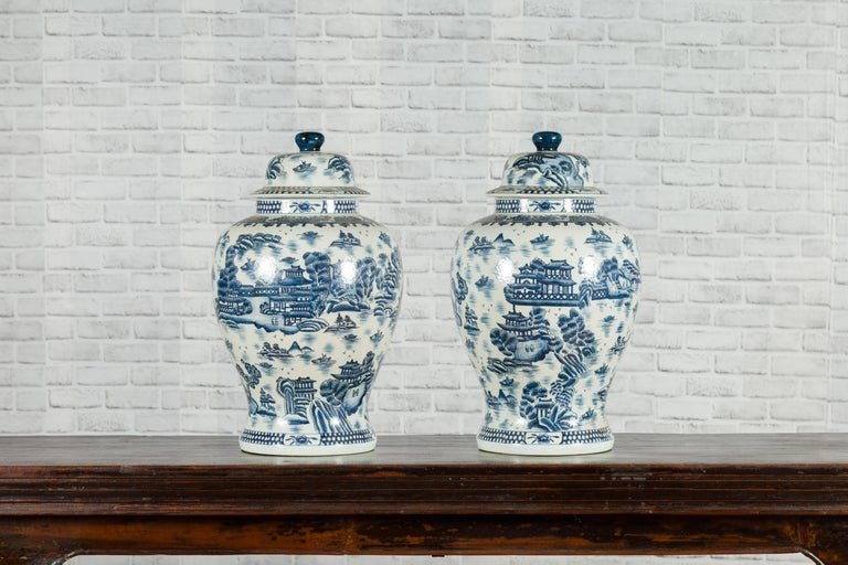 Pair of Vintage Chinese Blue and white Porcelain Temple Jars with Architectures In Good Condition For Sale In Yonkers, NY