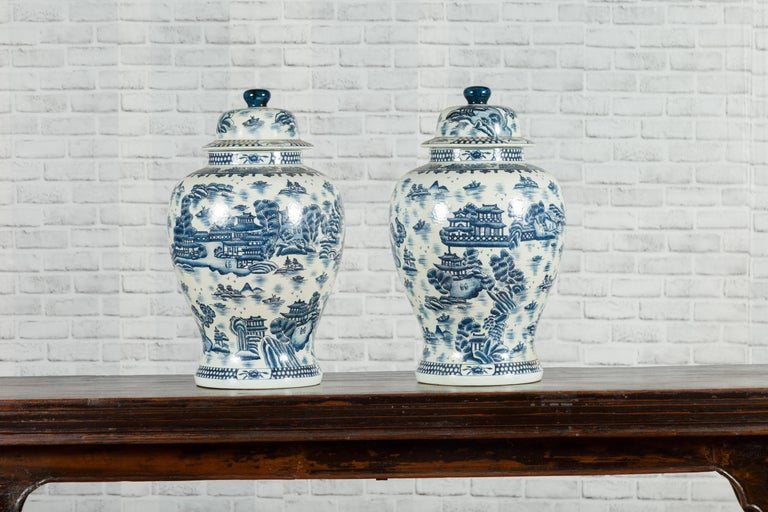 20th Century Pair of Vintage Chinese Blue and white Porcelain Temple Jars with Architectures For Sale