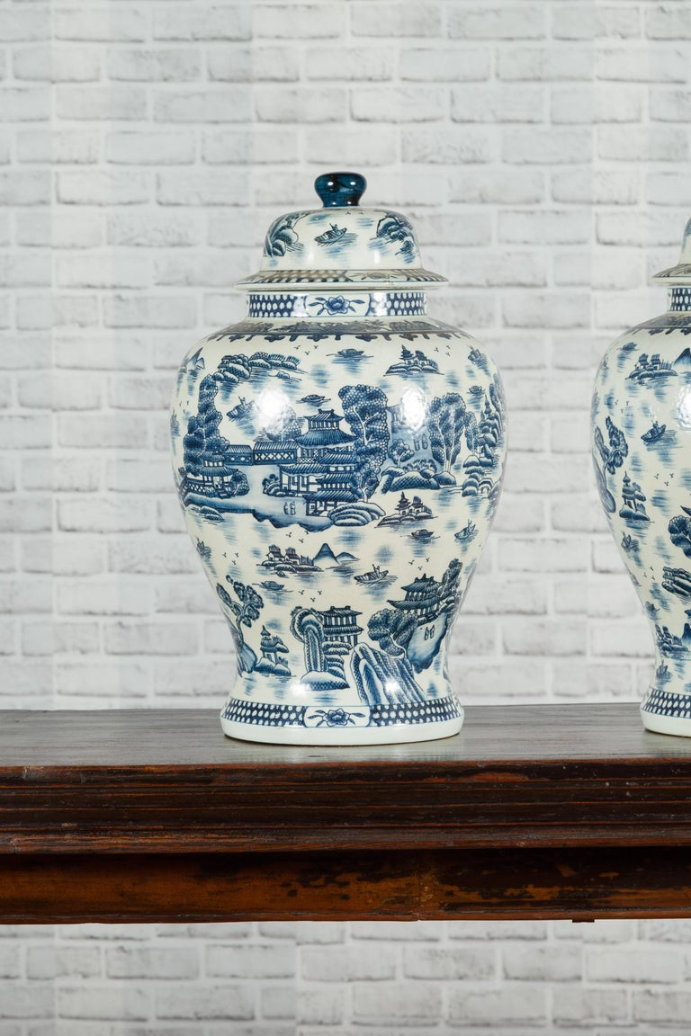 Pair of Vintage Chinese Blue and white Porcelain Temple Jars with Architectures For Sale 1