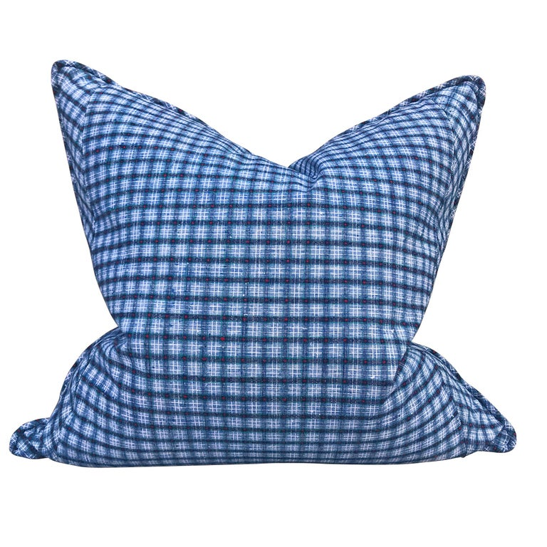 Pair of pillows made from vintage Chinese cotton panels with a large-scale indigo, crimson, and green plaid pattern on one side, and an indigo and crimson striped pattern on the reverse. With a self welt, and filled with down.