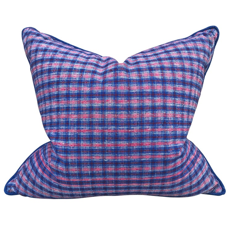 A pair of pillows made from vintage 20th century Chinese cotton panels with an indigo and crimson plaid pattern on one side, and a handwoven indigo cotton pattern on the reverse. With a self welt, and filled with down.