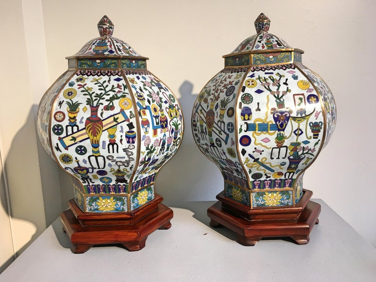 An impressive pair of vintage Chinese hexagonal covered cloisonné vases or jars featuring the