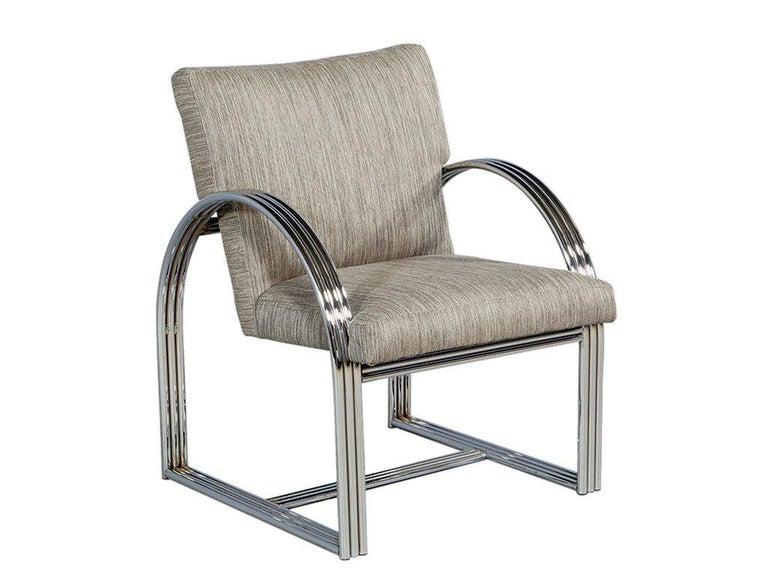 Pair of Vintage Chrome Side Chairs. Slick and unpretentious in the trademark Milo Baughman way, this set of two armchairs features a curved metallic frame coupled with earthy fabric cushioning. The original frame in polished chrome brings in a whole