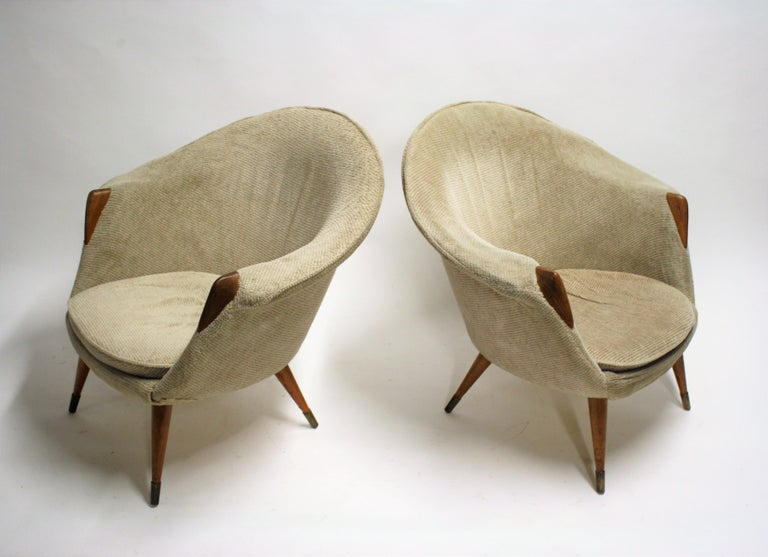 Pair of midcentury club or cocktail chairs upholstered in grey fabric with small wooden hand rests.  Beautiful, charming design. Mixes well with modern day interiors,  1960s, Belgium  Good condition.  Dimensions:  Height 72cm/28.5