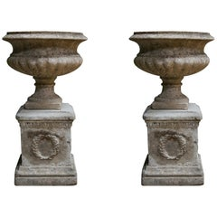 Pair of Vintage Composite Urns on Laurel Leaf Plinths
