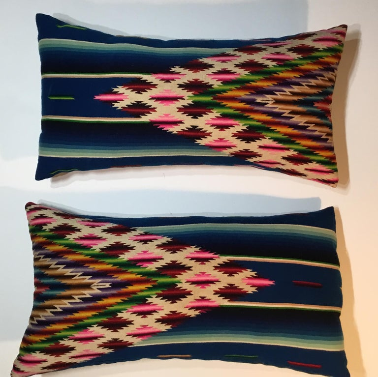 Beautiful pair of pillows made of finely handwoven multi-color vintage Saltillo Mexican blanket. Originally this price used as wall tapestry and we decided to make pillows from it .the pillows are made with the woven textile back and front ,with