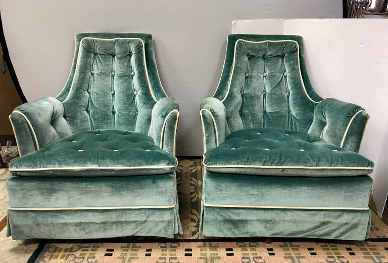 Midcentury 1960s velvet lounge chairs with button tufted back and seats in a beautiful robin's egg blue color. Chairs rock and swivel 360 degrees and are super comfortable.
